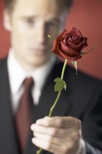 Man presents a rose