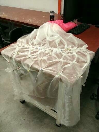 After I have finished attaching three dimensional objects on to the polyester fabric.