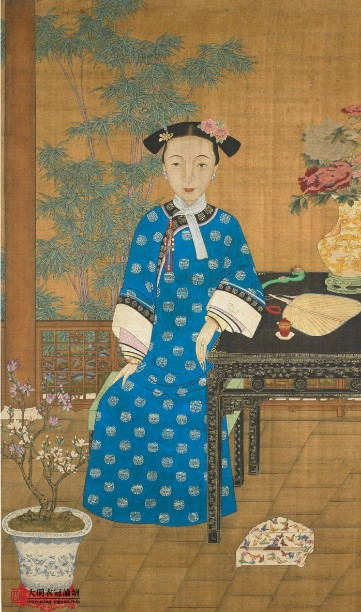 Portrait of Ci'an, Emperor Xianfeng's Empress Consort, with Two side bun and two flowers on hair image source: https://www.zhihu.com/question/28122982 last access 8th September 2016