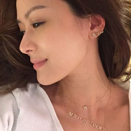 """Designer Yun Yun Sun wear her jewelry""""I'm Sexy And I Know It""""""""Awesome""""""""OMG""""""""Huh"""" image source: http://fashion.ettoday.net/news/669132 last access 1st September 2016"""