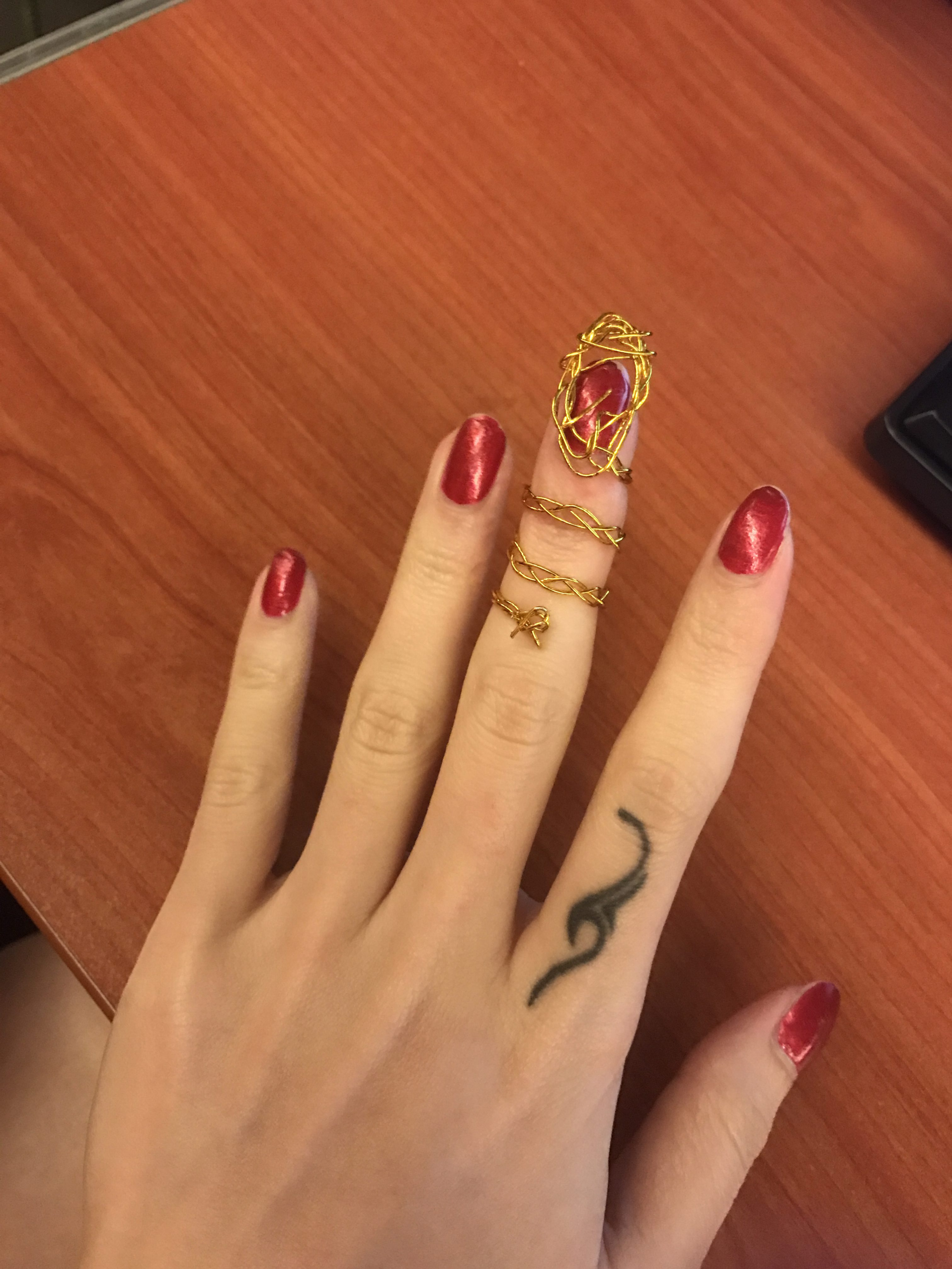 This is the wire version of the nail ring. I find it a bit inconvenient to bend my finger but not to a very bad extent. I do have some rings that will limit my finger movements. Normally when I need to do something important I will just remove the rings temporarily.
