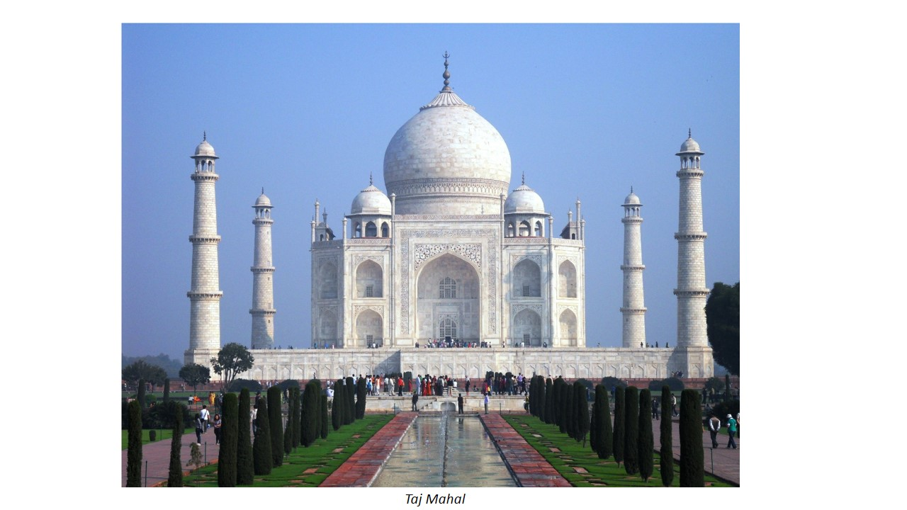 The Taj Mahal is an example of architecture that exhibits Reflection symmetry, whereby the peak of the architecture acts as the central vertical axis.